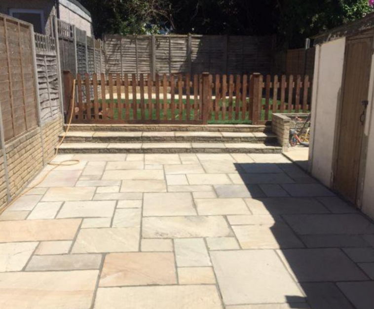 Sandstone patio and fencing